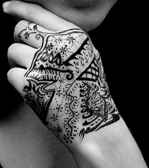Amazing Tribal Hand Tattoo