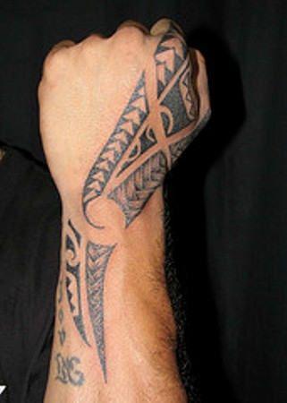 Awesome Black Ink Tribal Hand Tattoo
