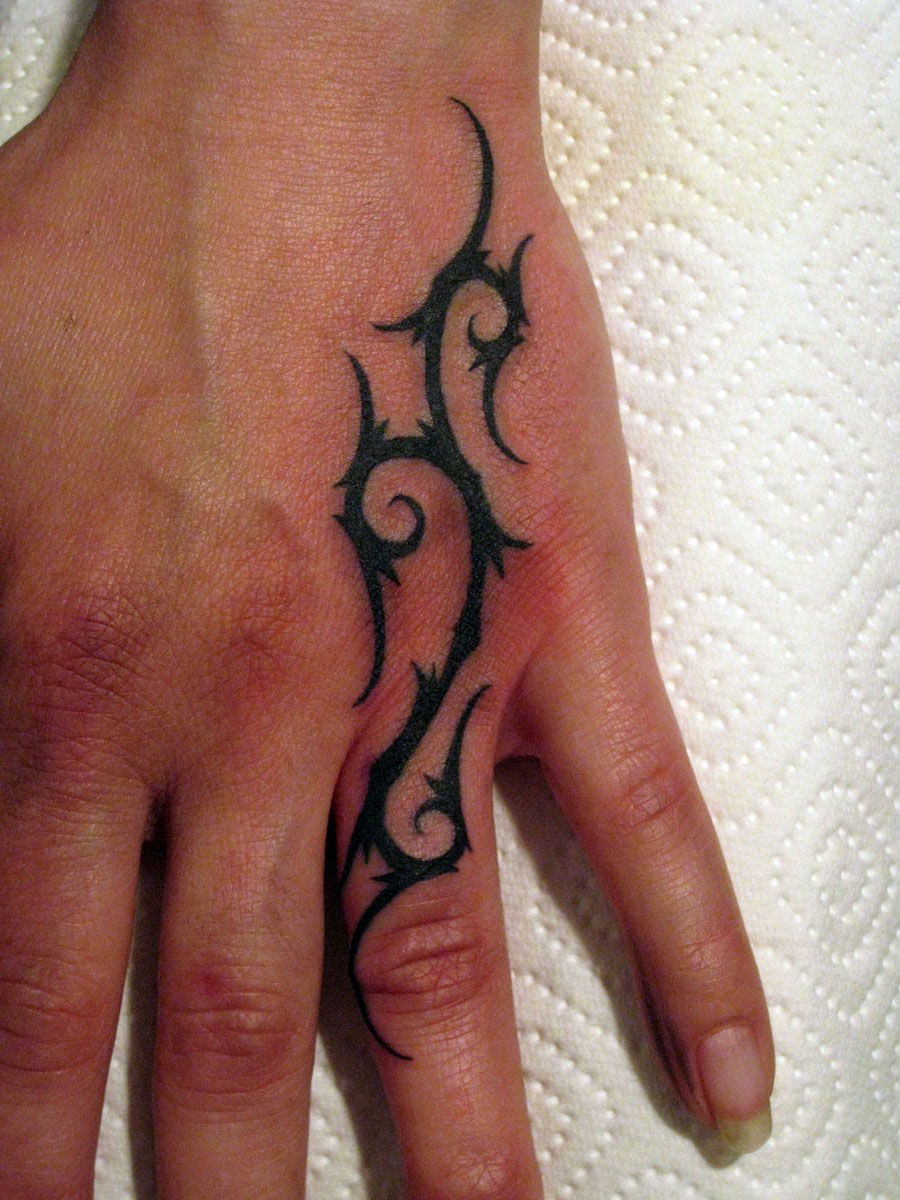 Awesome Black Tribal Tattoo On Left Hand