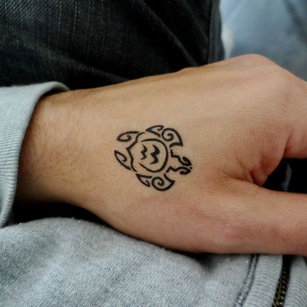 Nice Tribal Turtle Tattoo On Left Hand