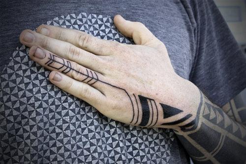 Traditional Nice Tribal Tattoo On Left Hand