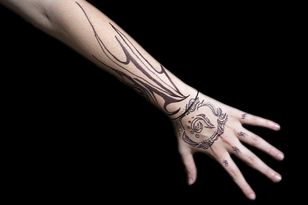 Tribal Tattoo On Left Hand And Arm