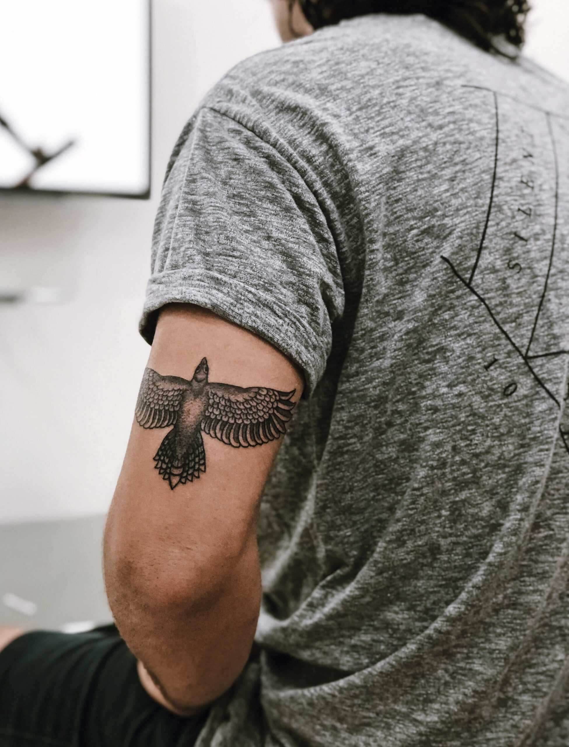 Black Ink Eagle Tricep Tattoo Design For Men