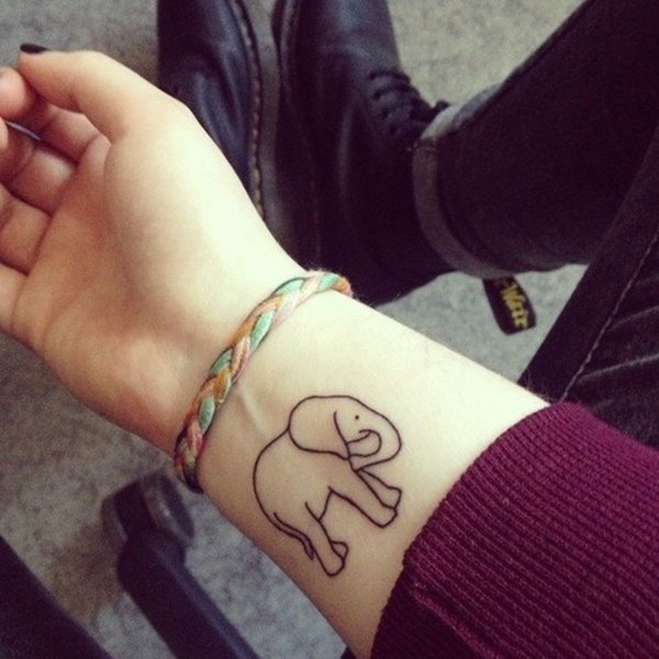 Black Outline Elephant Tattoo On Girl Right Wrist