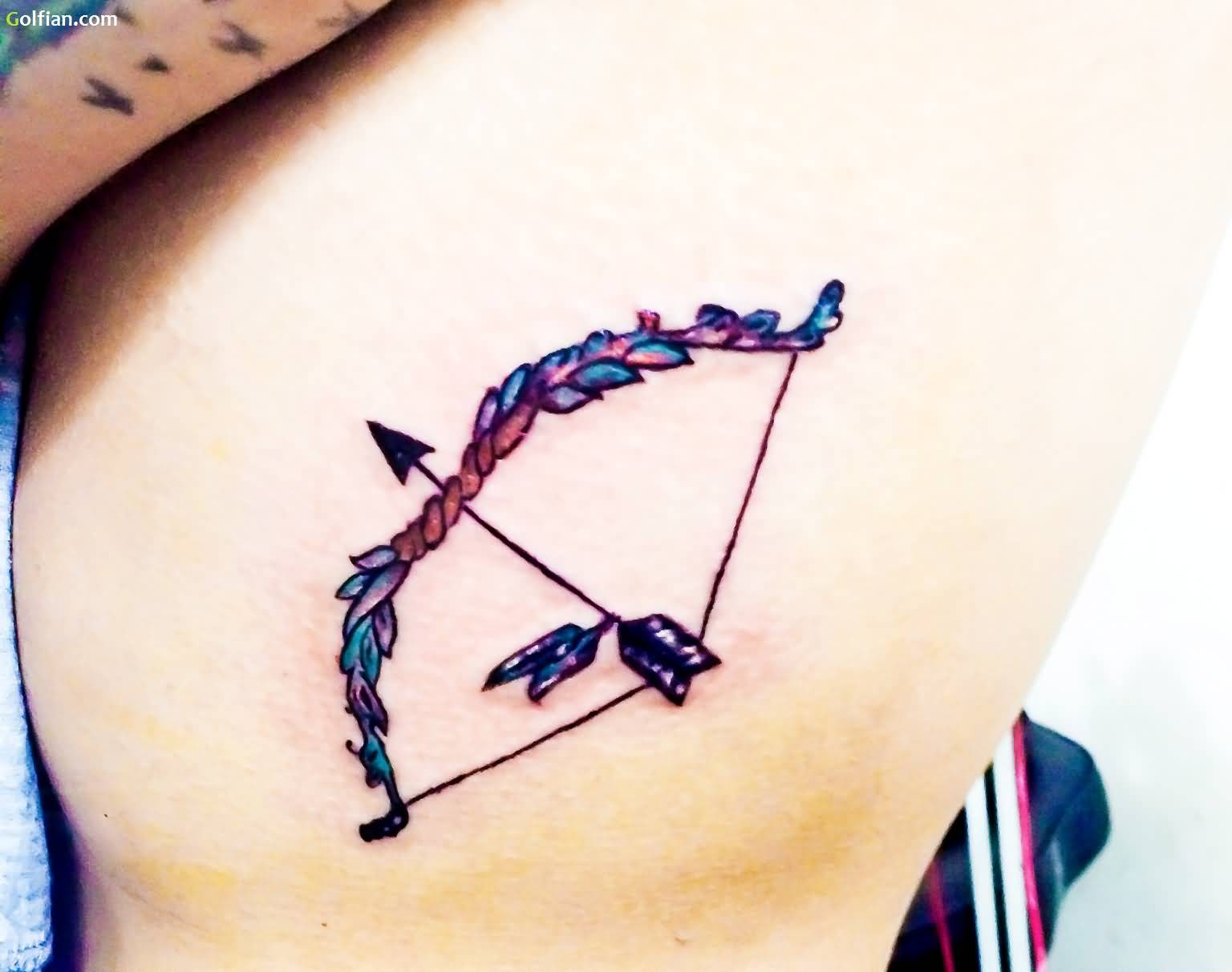 Great Vintage Bow And Arrow Tattoo On Rib