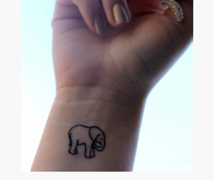Simple Black Outline Elephant Tattoo On Girl Right Wrist