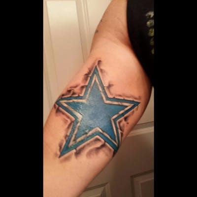 Smoked Dallas Cowboys Star Tattoo On Man Bicep