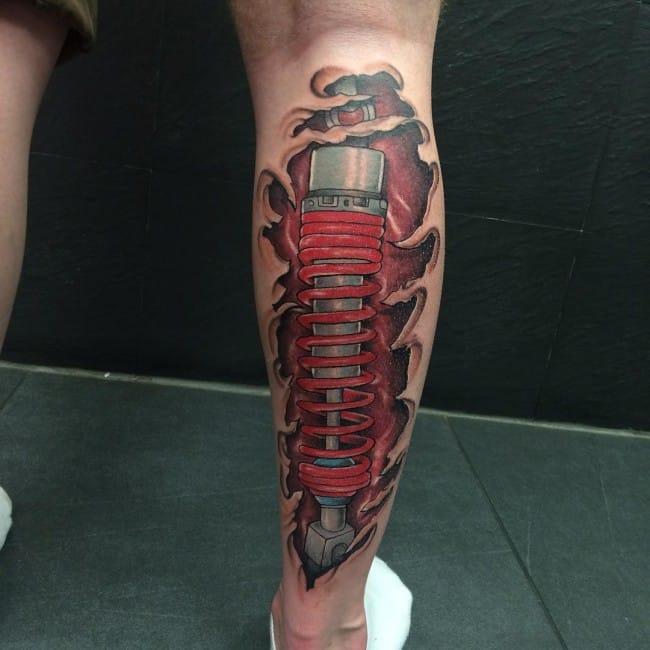 Trending Biomechanical Calf Tattoo