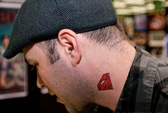 Red Superman Sign Neck Tattoo